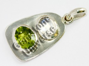 Peridot of 2.24 cts & Blue Moonstone of 2.03 cts Gemstoneuniverse.comf