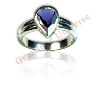 Absolutely Eye Clean and untreated Iolite from Madagascar set in Shakti energy ring. Gorgeous Violet Blue beating the color of a Blue Sapphire. Pear shaped Iolite-Shanipriya the divine gem of Lord Shani's consort.Gemstoneuniverse.com