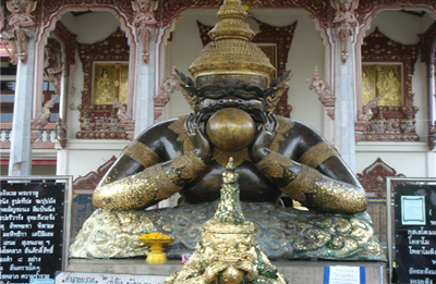 Wat Srisathong - Rahu statue in Thailand showing Rahu swallowing Sun and causing Eclipse
