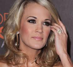 American Idol Winner Carrie Underwood wears a Fancy Yellow Diamond ring