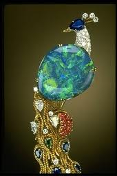 Ornate Jewelry Masterpiece with the Opal as the Center Gem