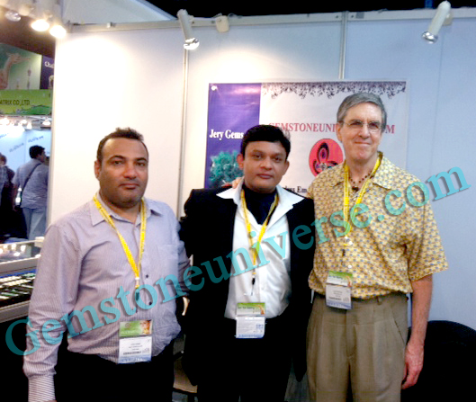 Guruji Shrii Arnav and Sriman Richard Shaw Brown With Mr. SM Askari head Gemstoneuniverse buying division at the Gemstoneuniverse exhibit, showcasing some exceptional planetary gems.