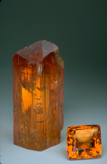 Imperial topaz crystal and a faceted gem at the smithsonian institute