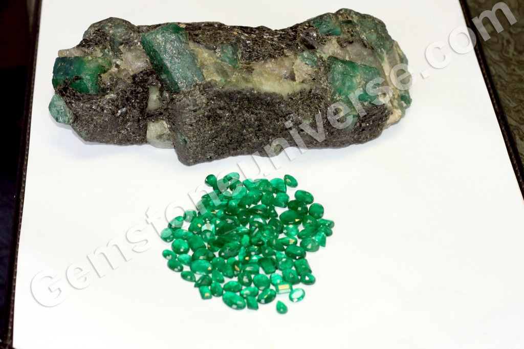 Zambian emerald rough with what the potential yield would look like.