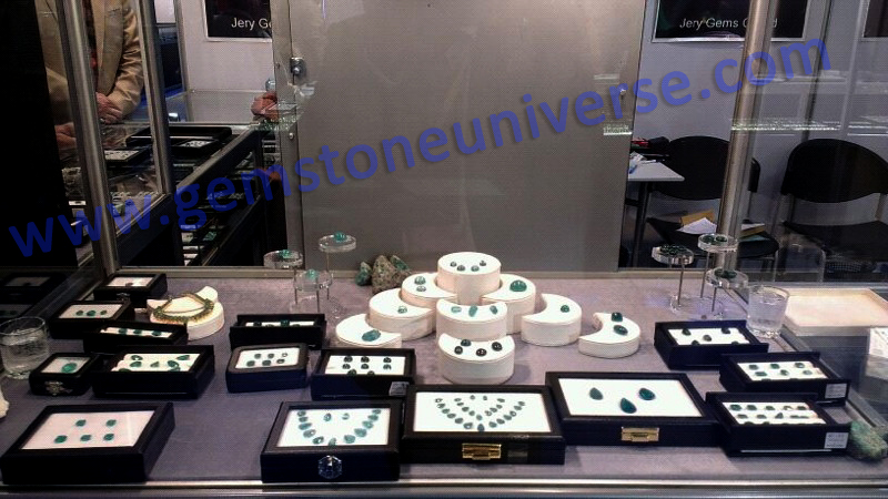 Section of Gemstoneuniverse exhibit showcasing Cabochons and Mineral Roughs