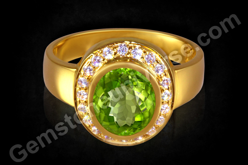 Brilliant Peridot Ring the beauty is augmented by the use of American Diamonds like a Halo