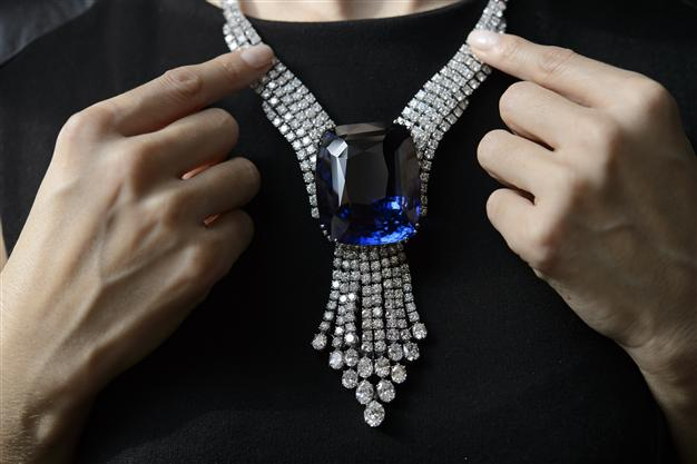 A Christie's employee holds The Blue Belle of Asia a 392.52 carats sapphire