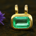 Fine Colombian Emerald set in Amulet Style Gold Pendant