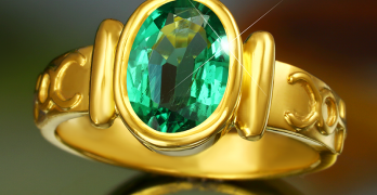 What Gemstone is good for business and financial development? Is it wearing a yellow sapphire or an emerald stone?