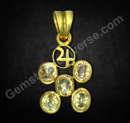 Exhibit showing a Jupiter Talisman having fine unheated Yellow Sapphires and sacred Jupiter Symbol. Unique implementation of Gem Therapy without compromising on Gem Quality