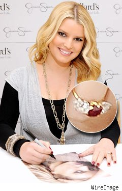 Jessica Simpson Sporting a 5 Carat Ruby with Diamonds as accent Stones-a Neil Lane Creation