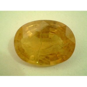 Poor Quality Mineral Sold as Yellow Sapphire in the market for Astrological Purpose. It Fails all Parameters of being a Gemstone let alone being a Jyotish Gemstone
