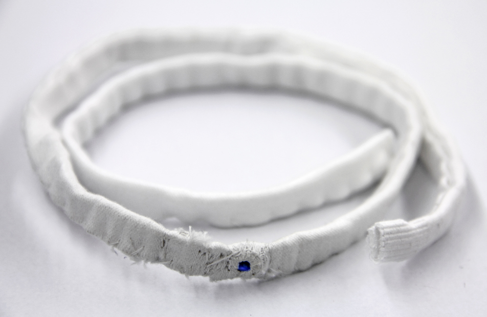 Sew your Blue Sapphire in a White cloth and Keep a portion exposed so that the Gem Touches you