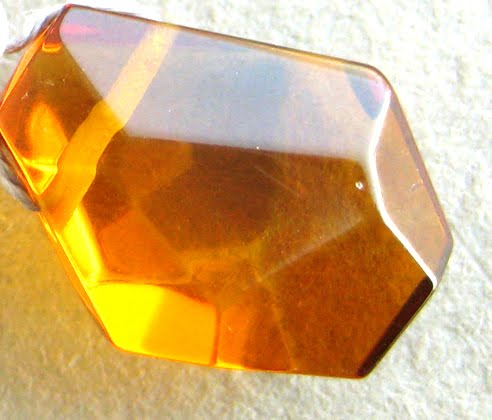 amber is not considered as a crystal